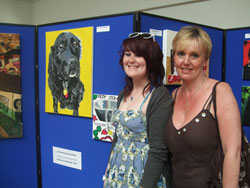 Art student showing off her coursework at the Art Exhibition