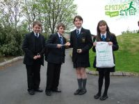 Pupils from the Eco Committee presenting pens to those pupils who participated in the Walk to School Week campaign
