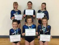 Team Effort Pays Off for Academy Acrobatic Gymnasts